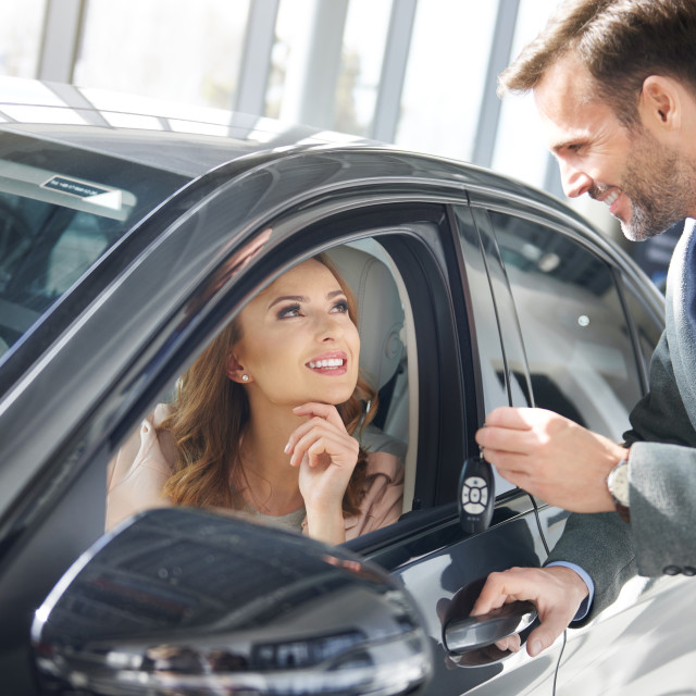 """""""Male trader pitching the car at the place of work"""" stock image"""