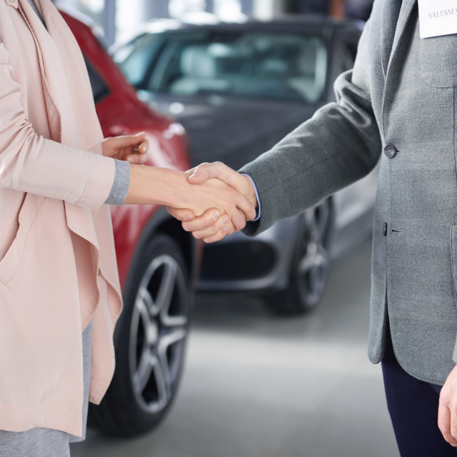 """Close up of handshake salesman and woman"" stock image"