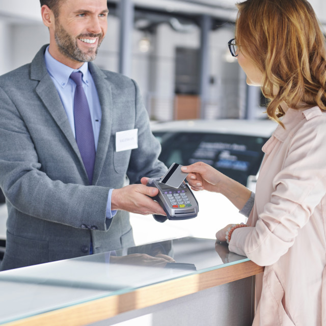 """""""Female customer paying for new purchase"""" stock image"""