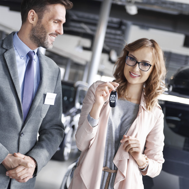 """""""Top view of new female car owner with salesman"""" stock image"""