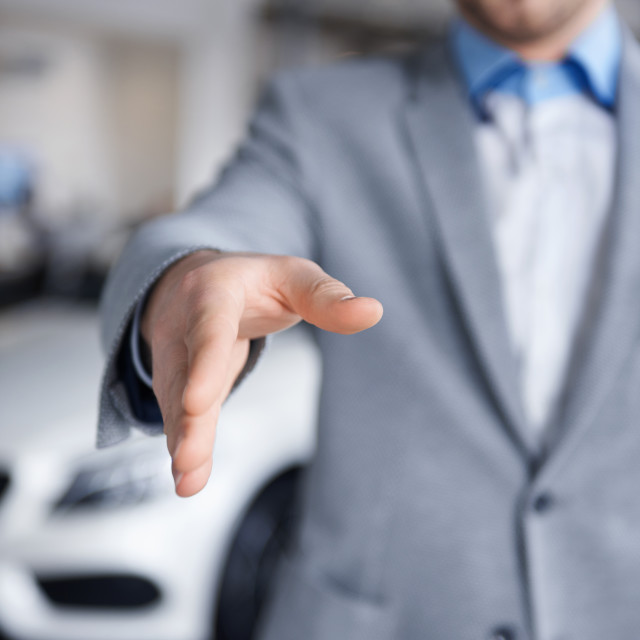 """""""Car dealer reaching out his hand"""" stock image"""