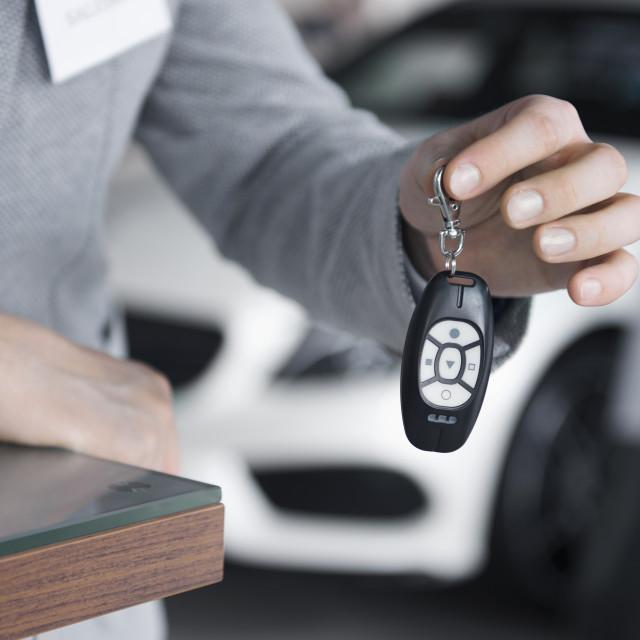 """Main view of salesman holding car keys"" stock image"