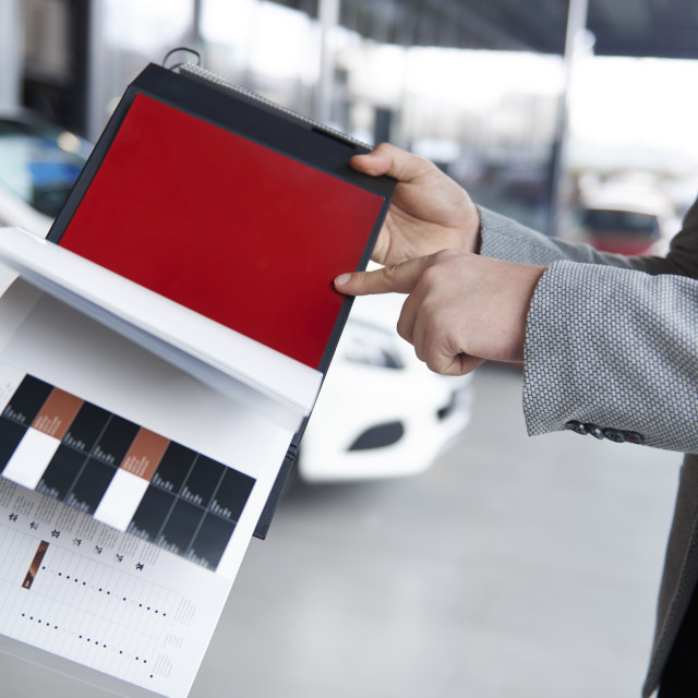 """""""Salesman higly recommend fashionable color"""" stock image"""