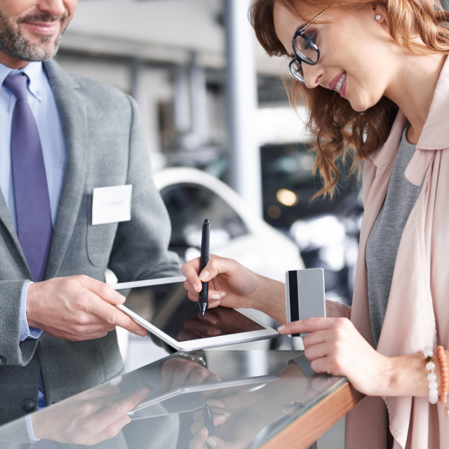 """""""Salesman using digital tablet to sign in"""" stock image"""