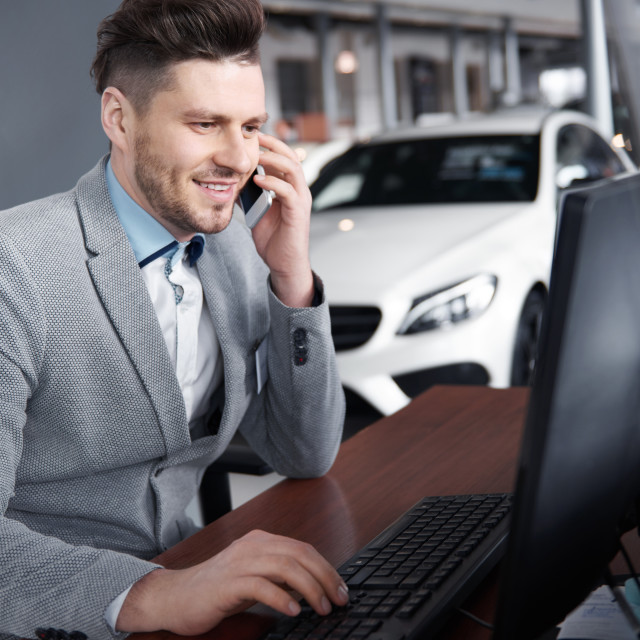 """""""Car dealer on the phone talking with client"""" stock image"""