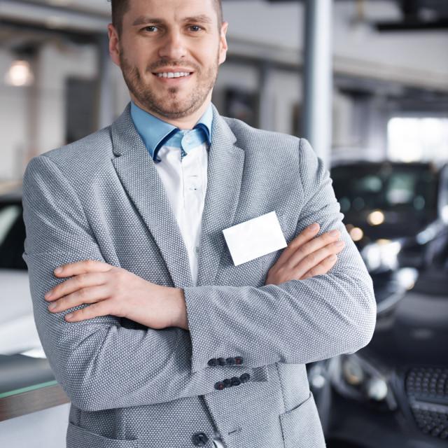 """Portrait of confident mid adult salesman"" stock image"