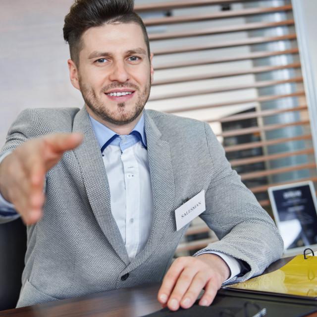 """Greeting car dealer at work place"" stock image"