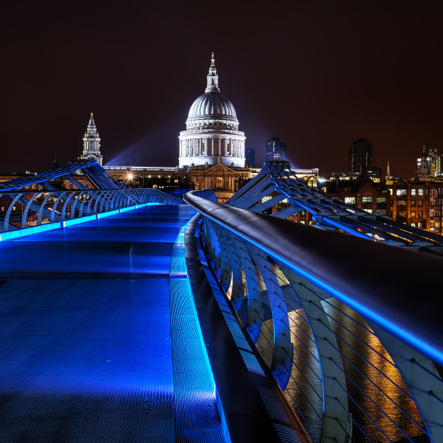 """blue millenium bridge at night in London"" stock image"