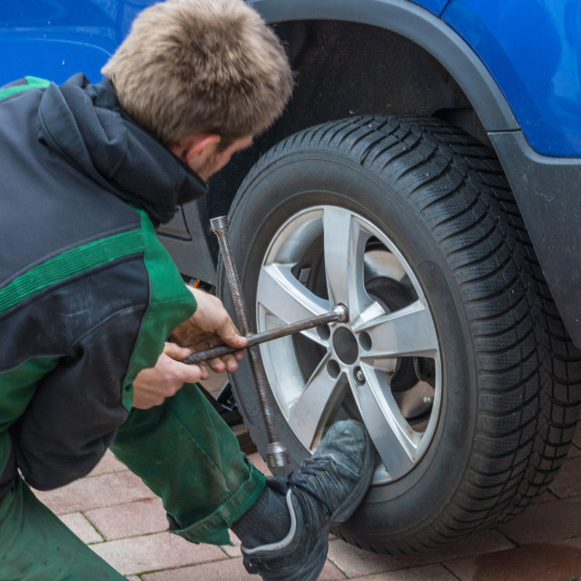 """Replace summer tires against winter tires"" stock image"