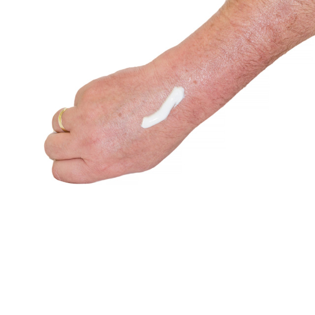 """""""Man's arm with a white cream"""" stock image"""
