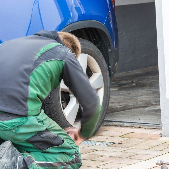"""""""Replace summer tires against winter tires"""" stock image"""
