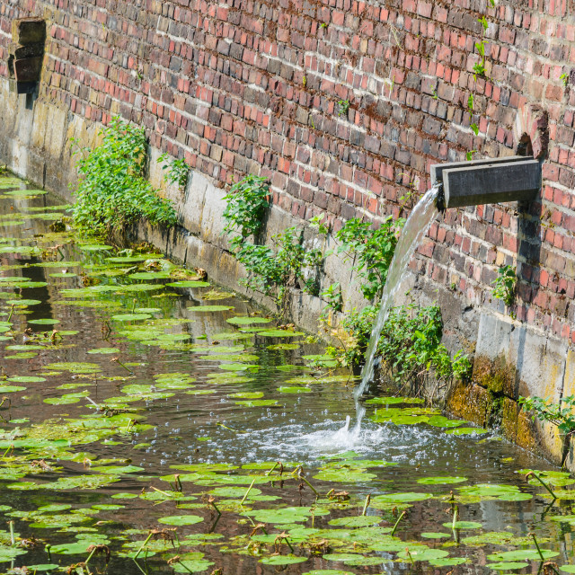 """""""Castle moat with rainwater inlet"""" stock image"""