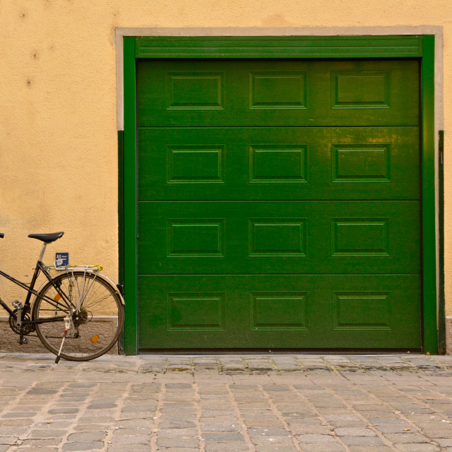 """Green Door with Bicycle"" stock image"