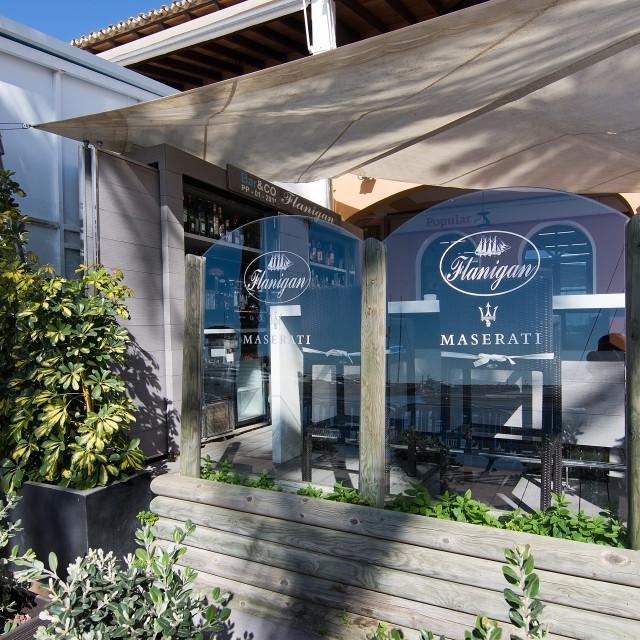"""Flanigan restaurant and Maserati icon"" stock image"