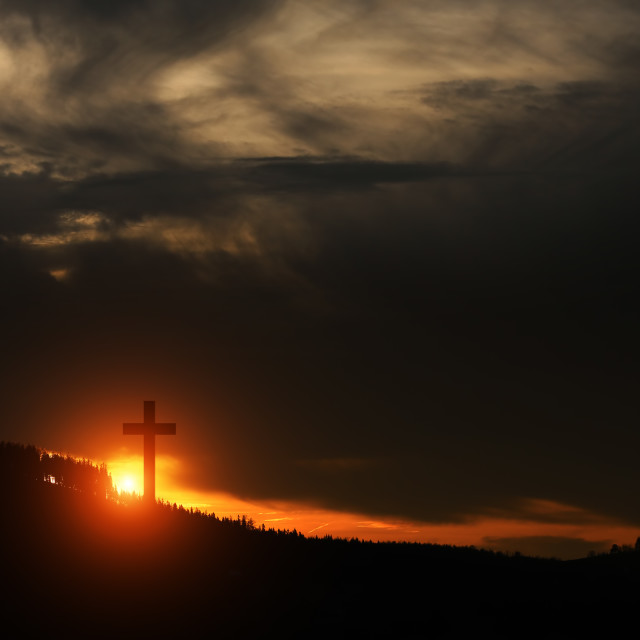 """Cross at sunset on the hill"" stock image"