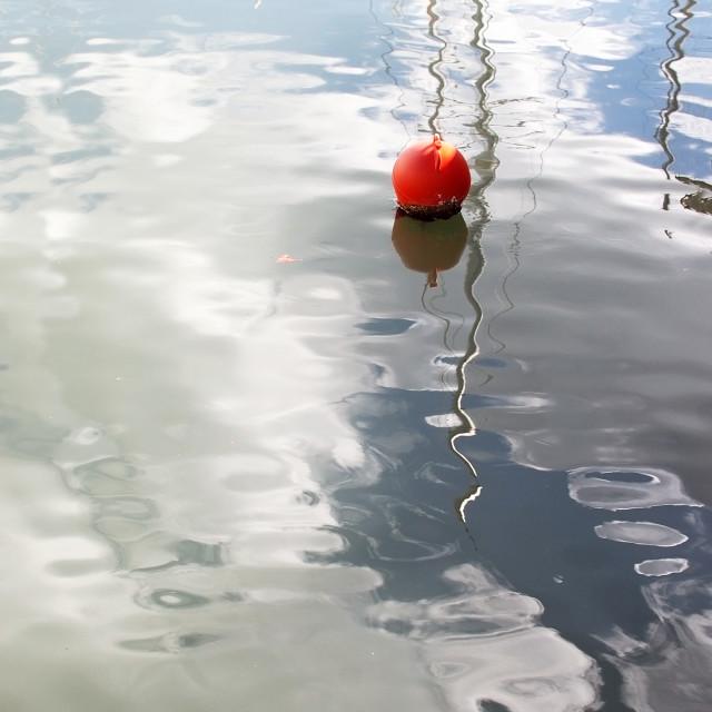 """Red buoy in marina"" stock image"