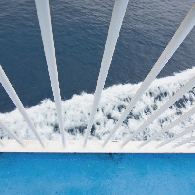 """Closeup white railing foamy Mediterranean water"" stock image"