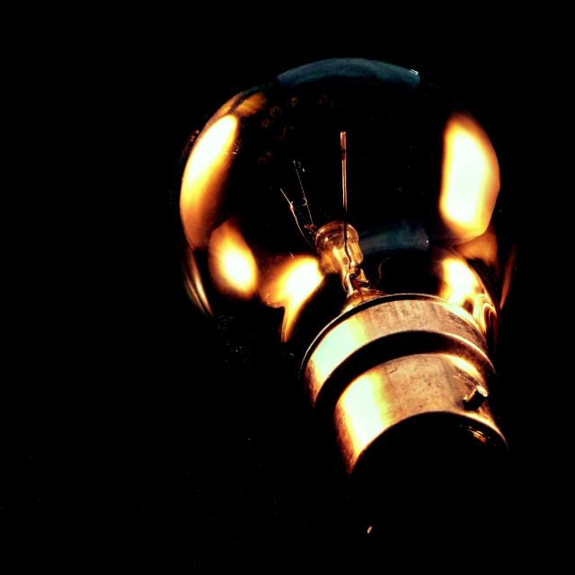 """Lightbulb in the dark"" stock image"