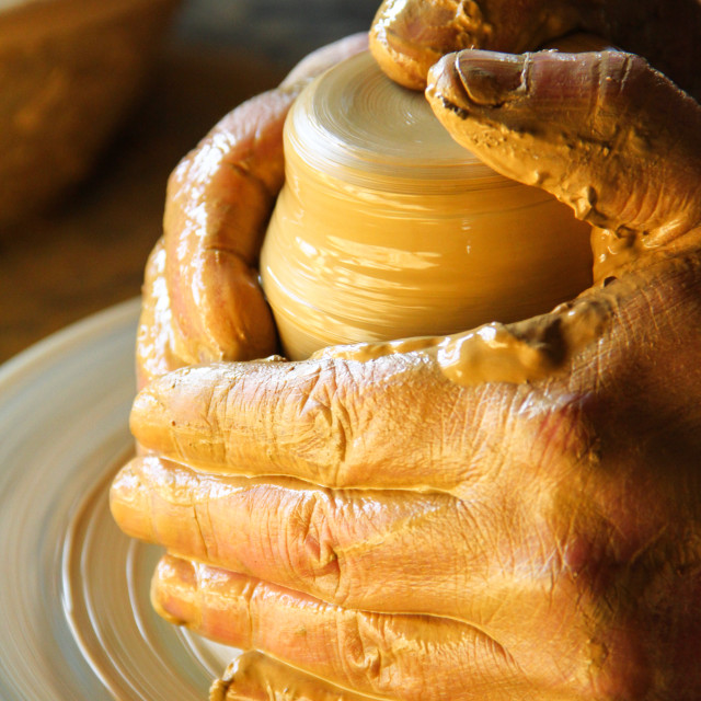 """hands of a potter, creating an earthen jar"" stock image"