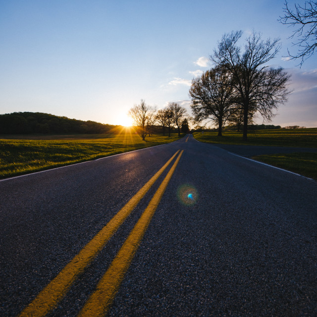 """""""The road and the setting sun"""" stock image"""
