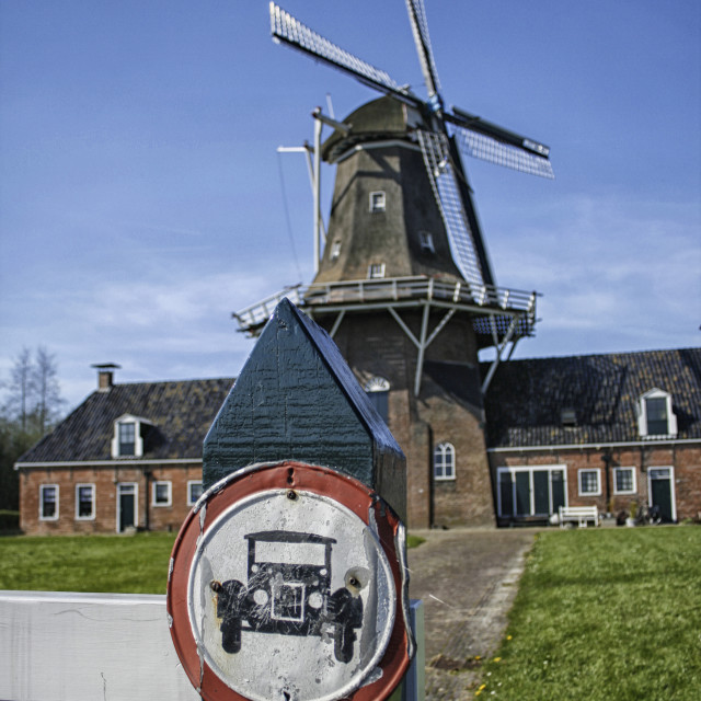 """Old windmill with sign"" stock image"