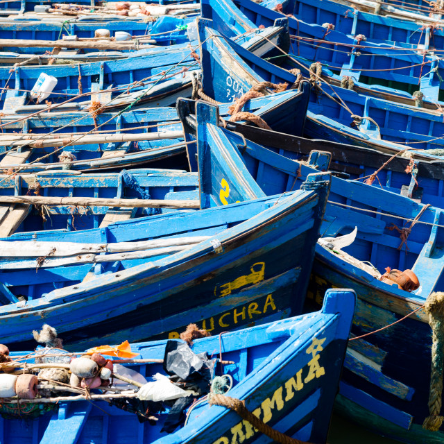 """Old wooden blue fishing boats in Essaouira sardines port"" stock image"