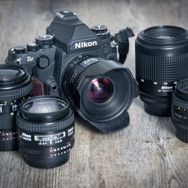 """Nikon Df dslr camera and a selection of lenses. Retro design."" stock image"
