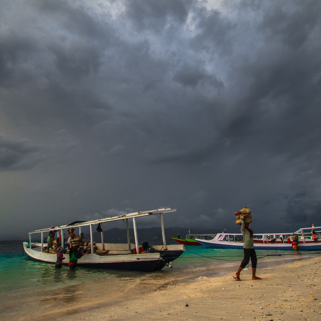 """Clouds over Gilitrawangan"" stock image"