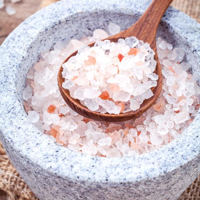 """""""Himalayan pink salt in mortar on hemp sack background. Himalayan salt..."""" stock image"""