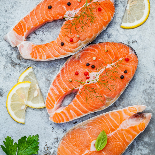 """Fresh salmon fillet sliced flat lay on shabby metal background. Raw salmon..."" stock image"