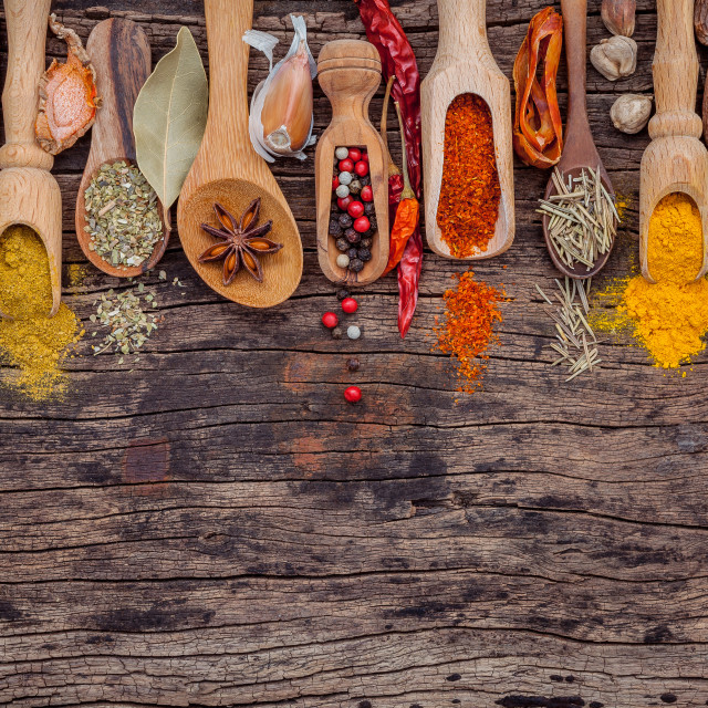 """Various of spices and herbs in wooden spoons. Flat lay of spices ingredients..."" stock image"