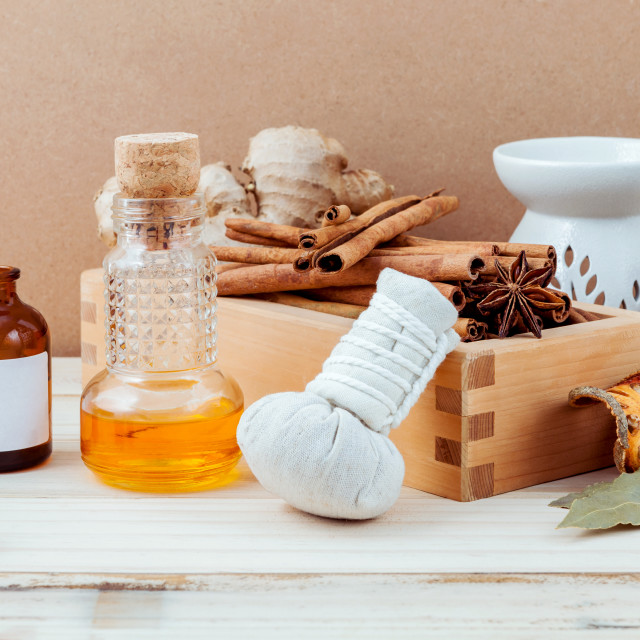 """Bottle of essential oil for ayurveda massage with cinnamon stick ,star anise..."" stock image"