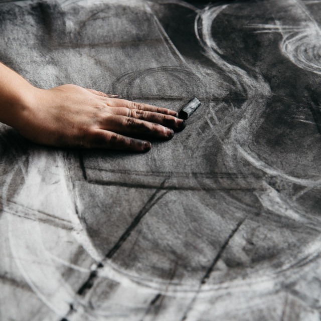 """Young artist painting with charcoal"" stock image"