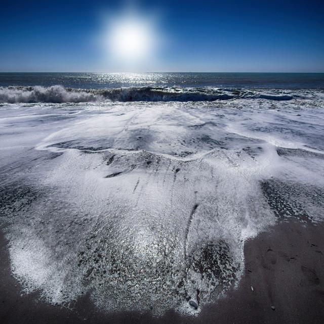 """Surf on black sand"" stock image"