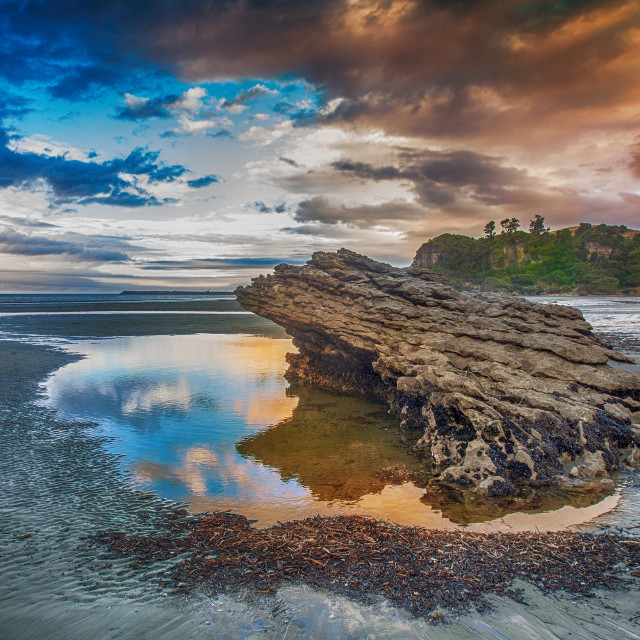 """Stranded rock at sunset"" stock image"