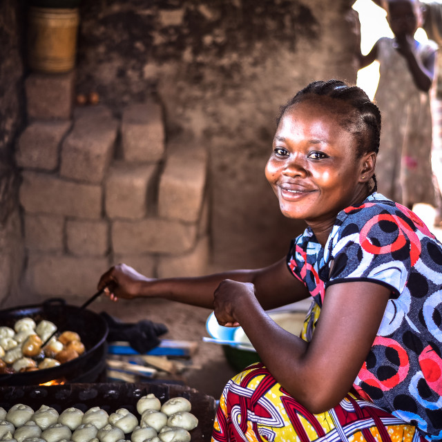 """""""African woman selling donut"""" stock image"""