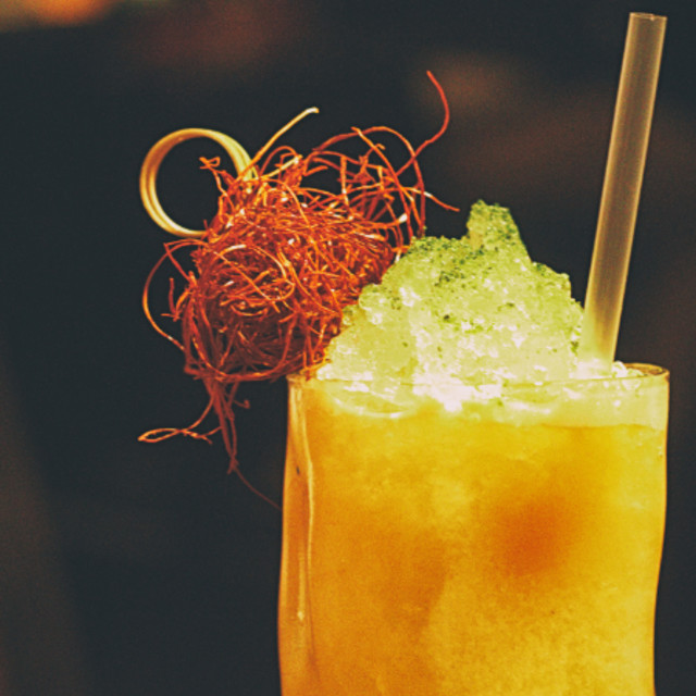 """A Cocktail topped wth chilli strands and wasabi powder"" stock image"