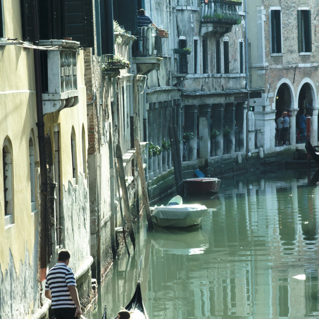 """A Canal and A Gondolier in Venice"" stock image"