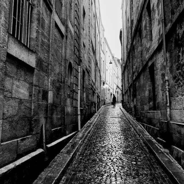 """A Silhouette on a Backstreet in Bordeaux"" stock image"