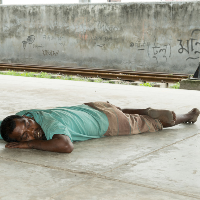 """""""a man sleeping on the road"""" stock image"""