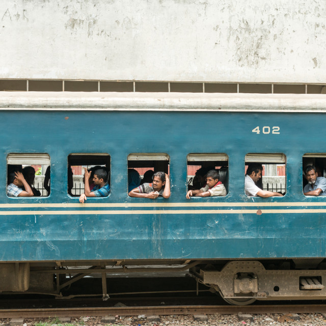 """""""Commuters in train looking through window"""" stock image"""