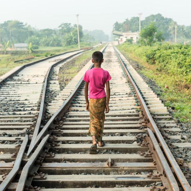 """""""a little boy walking on railway"""" stock image"""