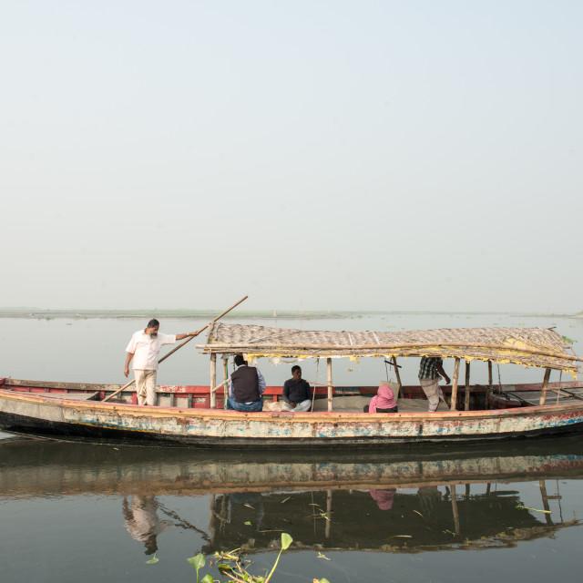 """Boat carrying Bengalese on black water, Dhaka, Bangladesh"" stock image"