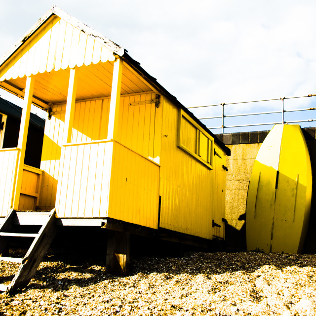 """Yellow beach hut and rowing boat"" stock image"