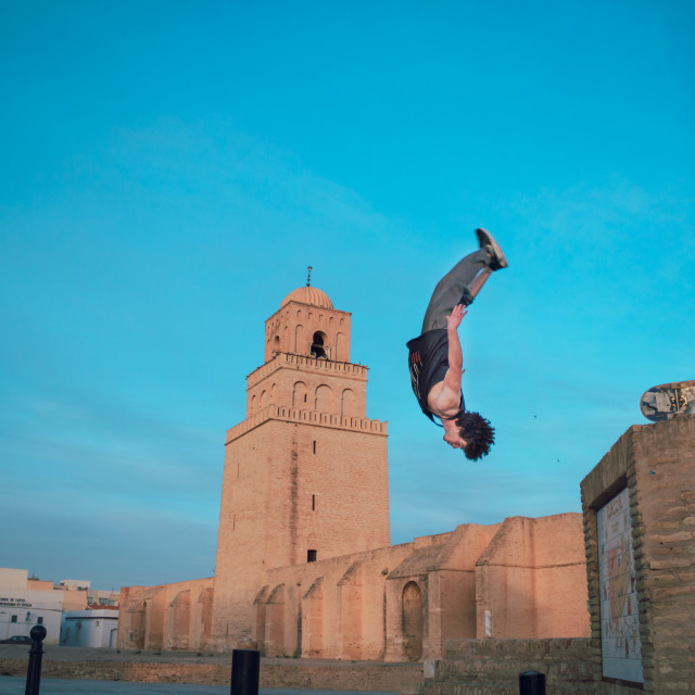 """Taher Nagati flying near the Great Mosque of Kairouan"" stock image"