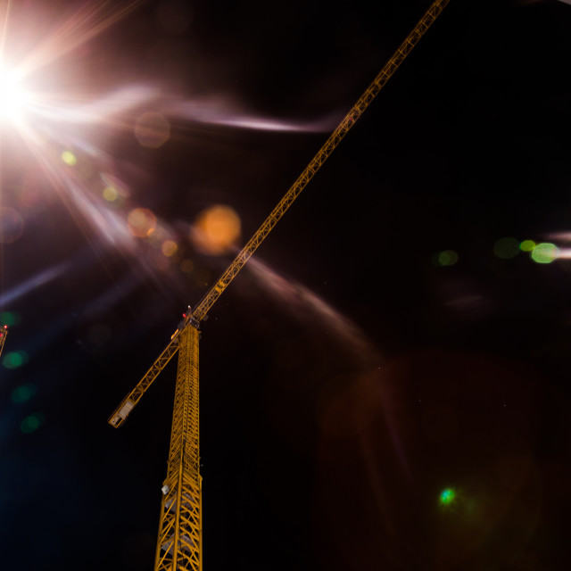 """Crane on building site in Hamburg. Night view from bottom up"" stock image"
