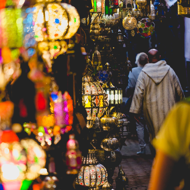 """Old medina souk market in Marrakesh. Path with colourful lamps"" stock image"