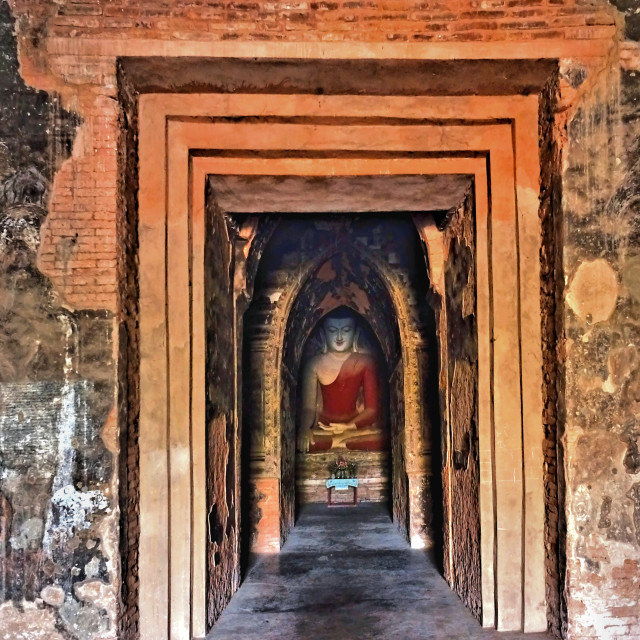 """""""Smiling Buddha deep in a temple, Bagan"""" stock image"""