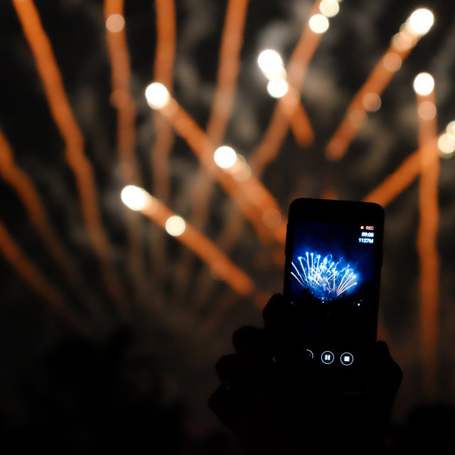 """Put your phone away, enjoy the fireworks"" stock image"