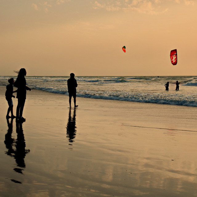 """Kitesurfing at sunset"" stock image"
